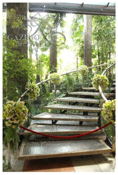 Landscaping blends with the flowers on the staircase railing