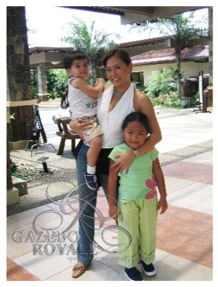 Ms. Karen Davilla joyfully poses with her son and our Danni
